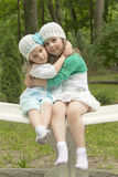 Sisters in park on a bench Stock Images