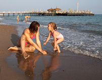 The sisters play on the beach. Royalty Free Stock Photography