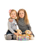 Sisters play on the floor Royalty Free Stock Photography