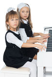 Sisters play the piano Royalty Free Stock Photo