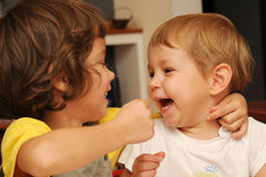 Sisters playing. Two cute sisters playing and laughing happily Stock Photography