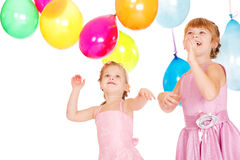 Sisters playing with balloons Stock Photo