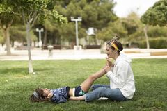 Sisters playing happily in a park. royalty free stock image