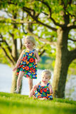 Sisters playing outside royalty free stock image