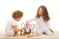 Sisters playing with wooden toy Royalty Free Stock Images
