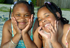 Sisters portrait. Two smiling african american sisters on a beach Royalty Free Stock Photography
