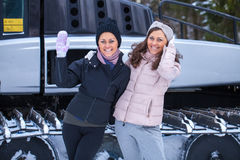 Sisters posing on ski resort Stock Photo