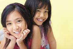 Sisters posing to camera together Stock Photography