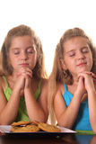 Sisters praying Stock Images