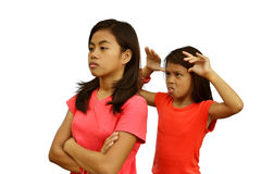 Sisters Quarrel. A teenage girl angry with her rude younger sister Stock Photography