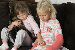 Sisters reading Royalty Free Stock Photo