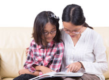Sisters Reading Book Together Stock Photography