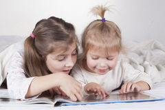 Sisters Reading Time Royalty Free Stock Image