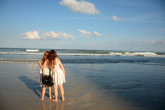 Sisters relaxing on beautiful beach. Royalty Free Stock Photos