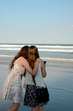 Sisters relaxing on beautiful beach. Stock Photo