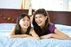 Sisters relaxing and having fun at home Royalty Free Stock Photography