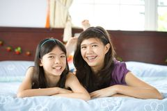 Sisters relaxing and having fun at home Stock Images