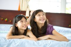 Sisters relaxing and having fun at home Royalty Free Stock Photo