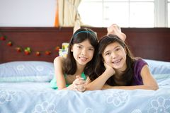 Sisters relaxing and having fun at home Royalty Free Stock Photos