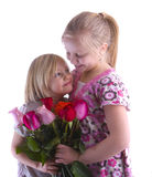 Sisters With Roses Royalty Free Stock Image