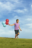 Sisters Running With Balloons Royalty Free Stock Photos