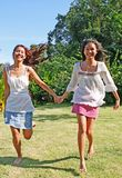 Sisters running in the park Royalty Free Stock Photos