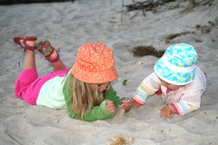 Sisters on the sand Stock Photography