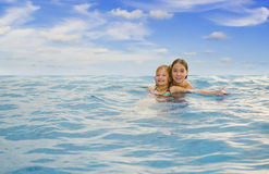 Sisters in the sea Royalty Free Stock Image