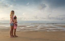 Sisters at seashore Stock Photo