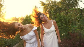 Sisters shake their hair stock footage