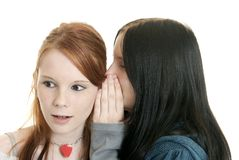 Sisters sharing secrets Royalty Free Stock Photo