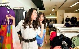 Sisters shopping clothes Stock Photos