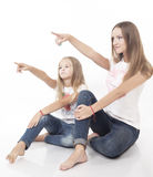 Sisters show on something interestedly Royalty Free Stock Image