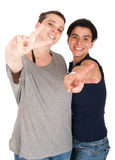 Sisters showing victory sign Royalty Free Stock Image