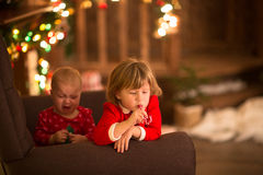 Sisters (siblings) on  brown chair, Christmas or New Year concep Royalty Free Stock Photo