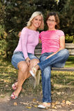 Sisters sitting on a bench Royalty Free Stock Photography