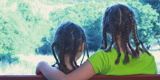Sisters Sitting On Park Bench Royalty Free Stock Photography