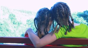 Sisters sitting on park bench Royalty Free Stock Photos