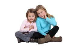 Sisters sitting together Stock Photos