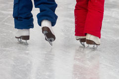 Sisters on Skates. Two sisters skating on an outdoor rink Royalty Free Stock Photo