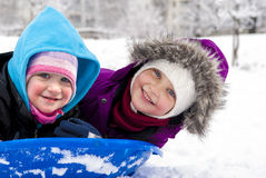 Sisters on sled Stock Images