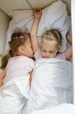 Sisters sleep on the bottom shelf in a train Stock Photography