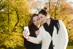 Sisters with smartphone Stock Image