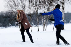 Sisters snow ball fight. Two sisters having a snow ball fight Royalty Free Stock Images