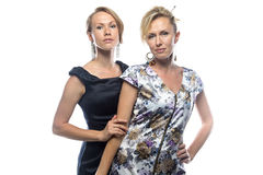 Sisters standing on white background. Isolated photo on white background Stock Photos