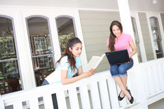 Sisters Studying at Home Stock Photography
