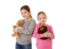 Sisters with teddybears Stock Image