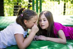 Sisters Telling Secret stock photos