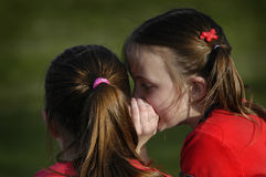 Sisters Telling Secrets to Each Other Whispering in Ears. Sisters telling secrets friends by whispering in ears to each other Stock Photos