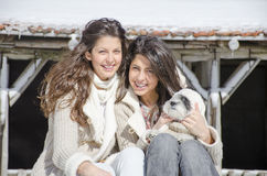 Sisters with their little dog Royalty Free Stock Photo